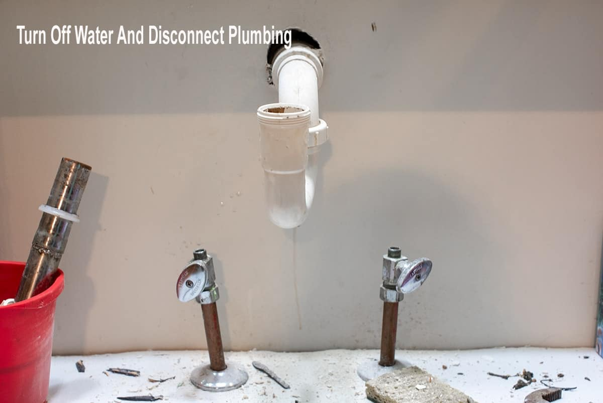 Replacing a faucet by disconnecting plumbing.