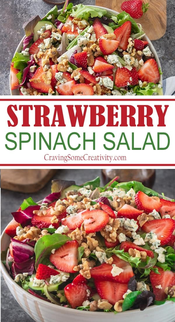 Strawberry spinach salad showed in a white bowl with blue cheese crumbles, chopped walnuts and spring greens.