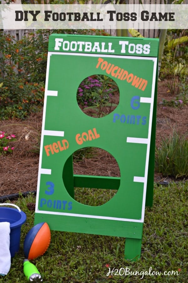 DIY football toss game.mage Green with white field-like markings. Background image is a flower garden.