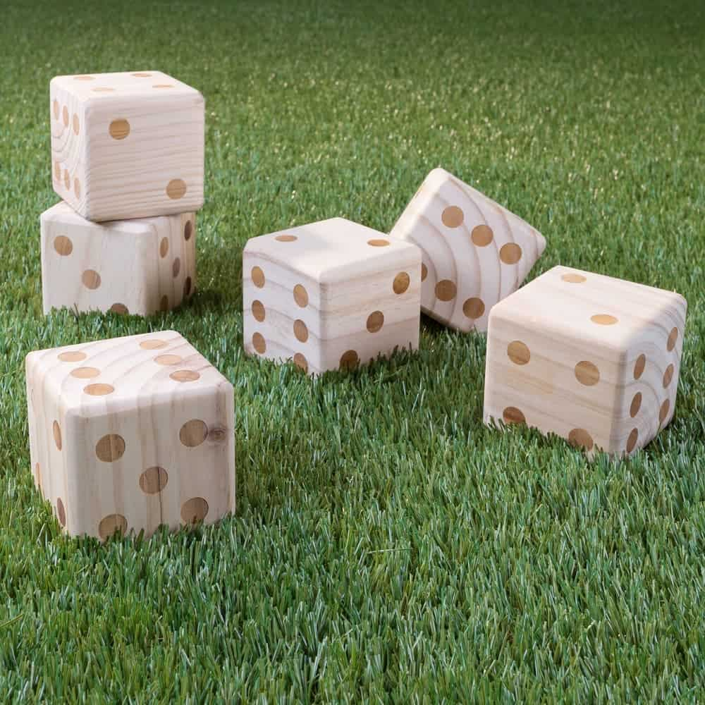 Giant natural wood lawn dice game on grass background.