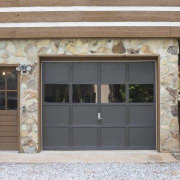 Gray garage door with windows.
