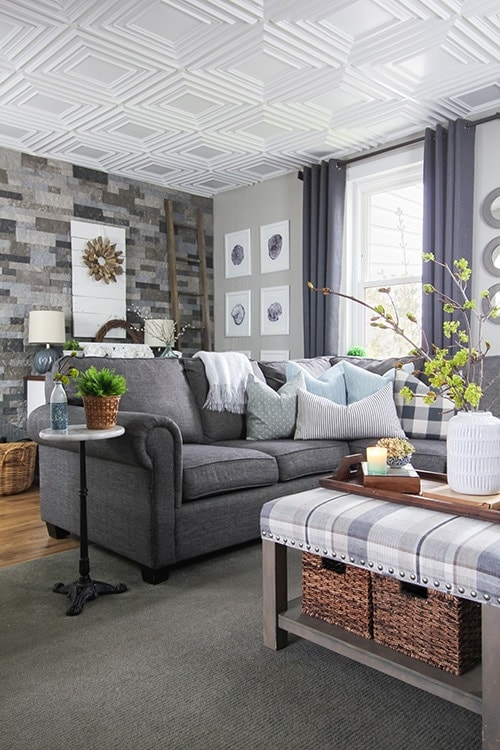 Modern white square style drop down pop out ceiling styles in a modern farmhouse styled living room with gray neutral palette.