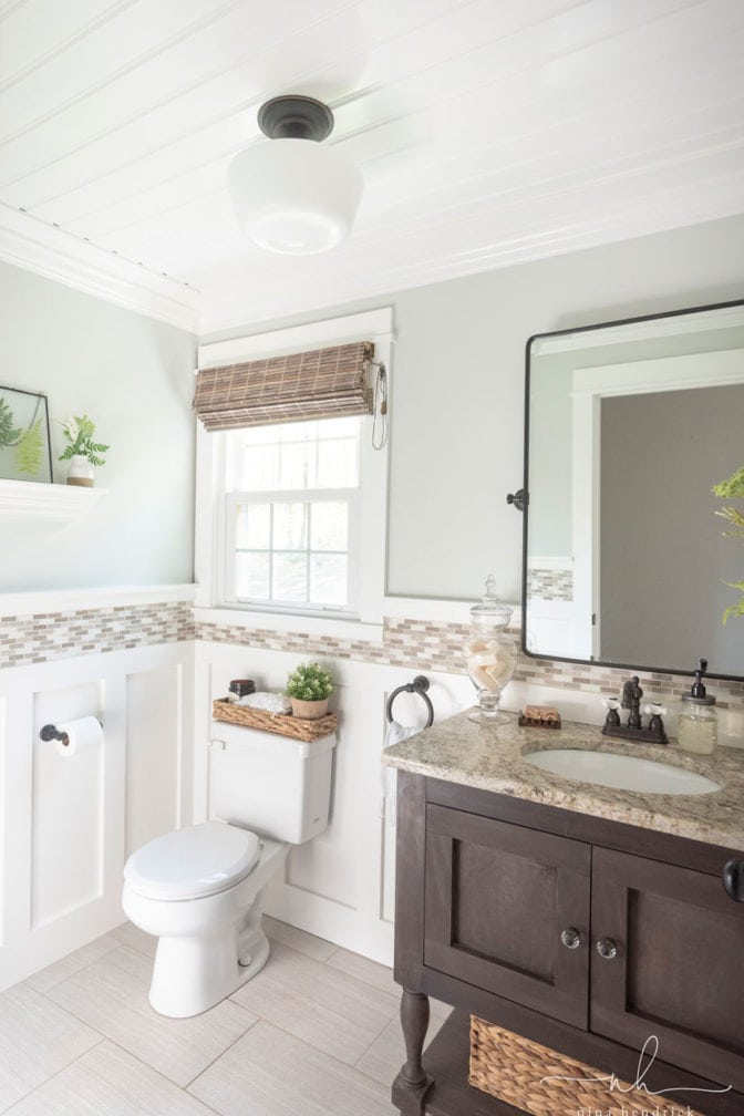 White beadboard ceiling in powder room styled with natural accents and earth tones.