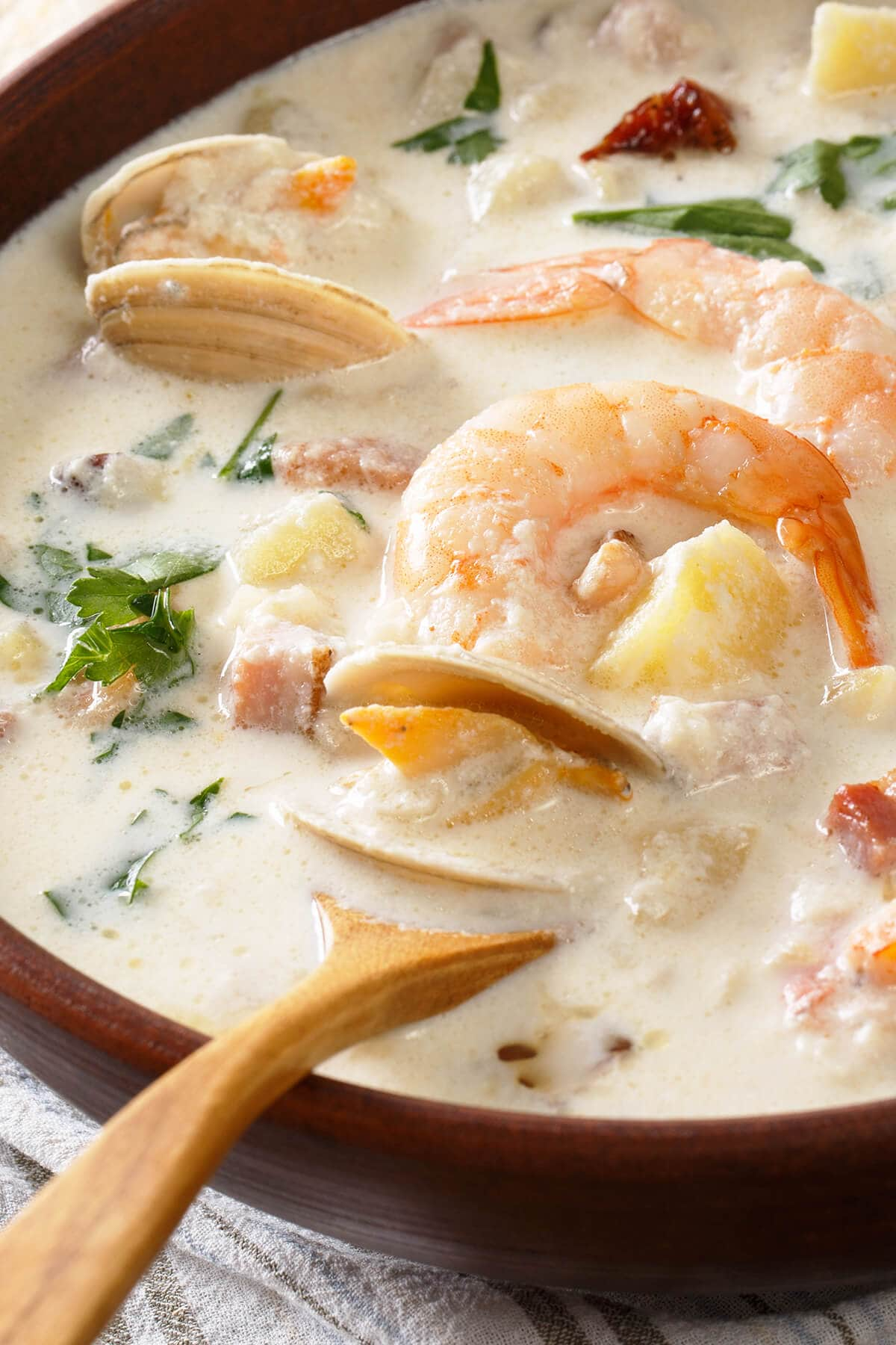 Close up of seafood chowder with mussels and shrimp