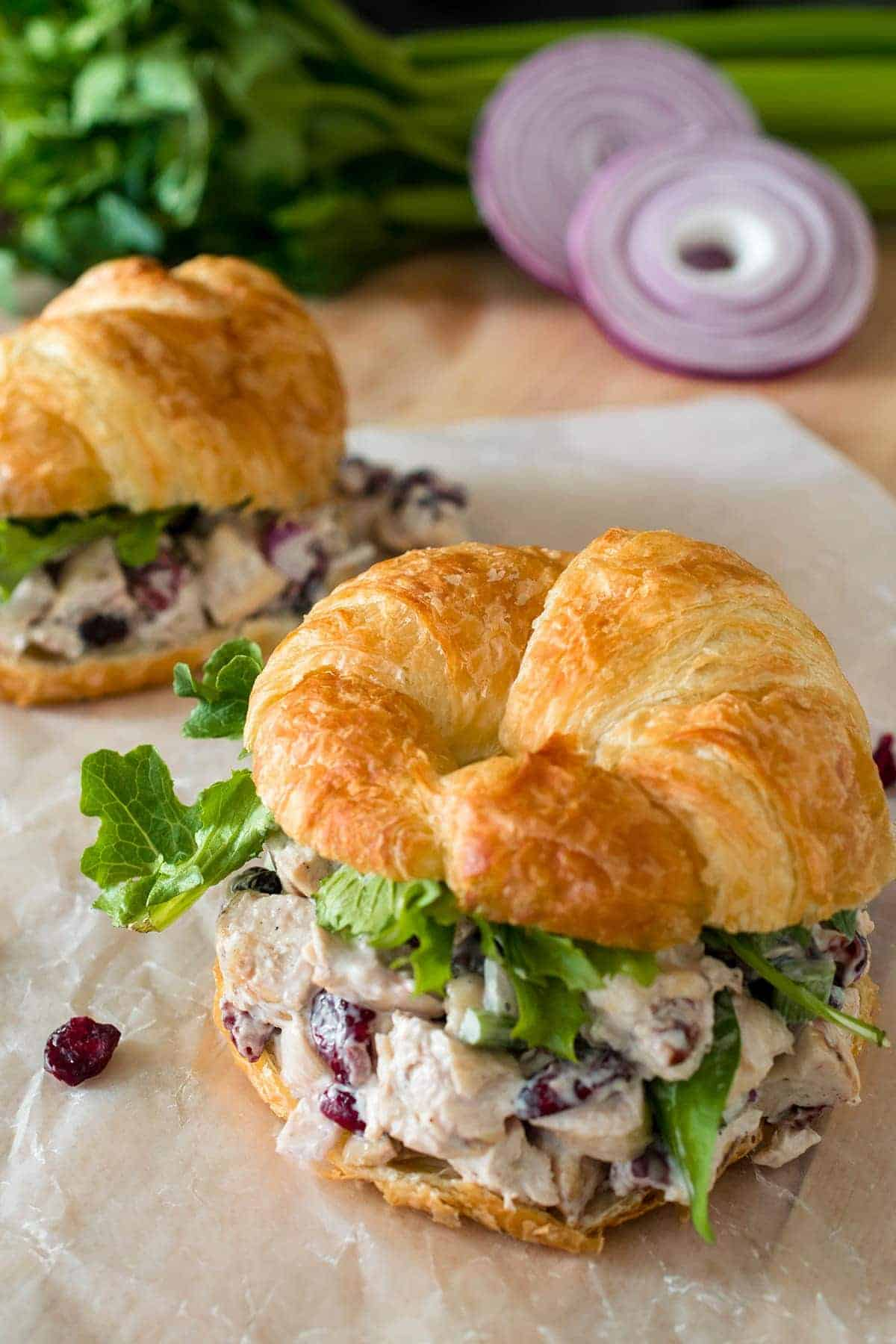 Cranberry Chicken Salad on a Croissant with romaine lettuce for a healthy lunch