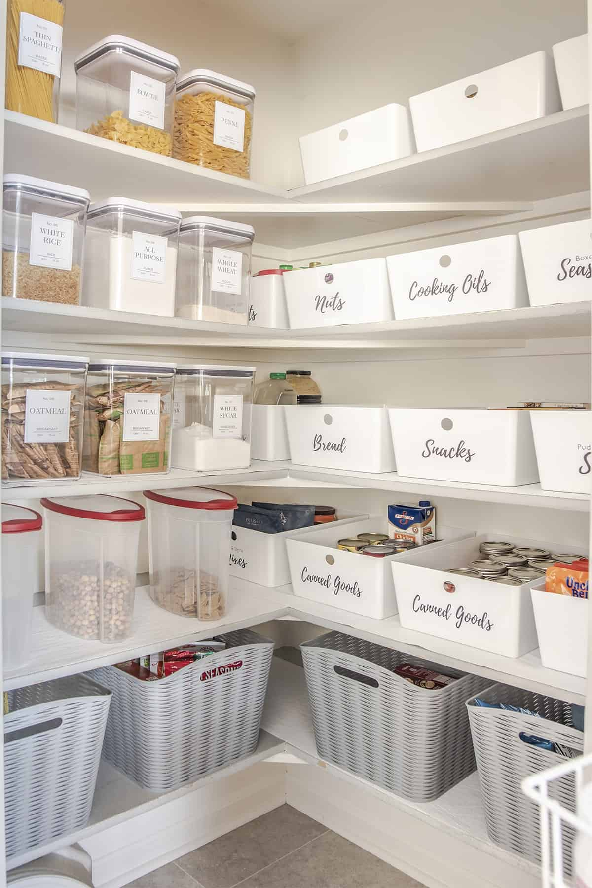 Clear labeled canisters keep dry goods handy. Wide labeled flats keep snacks, canned goods and other items organized on shelves.