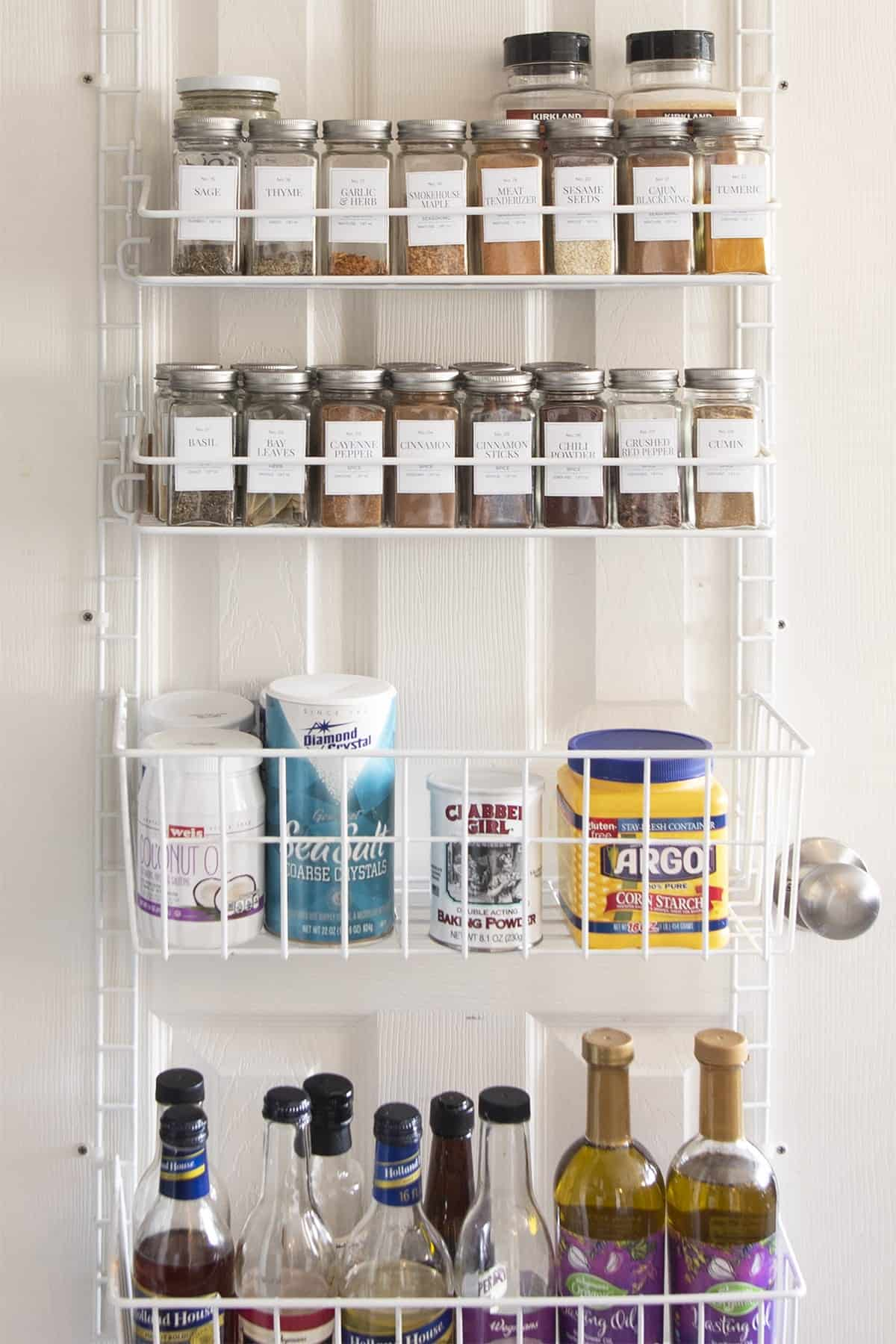 Over-the-door wire rack keeps spices, cooking oils and baking items organized and handy.