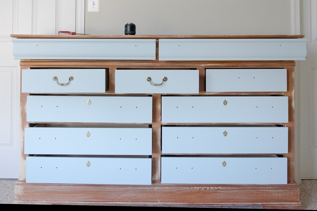 Painting a dresser while the drawers are still in it.