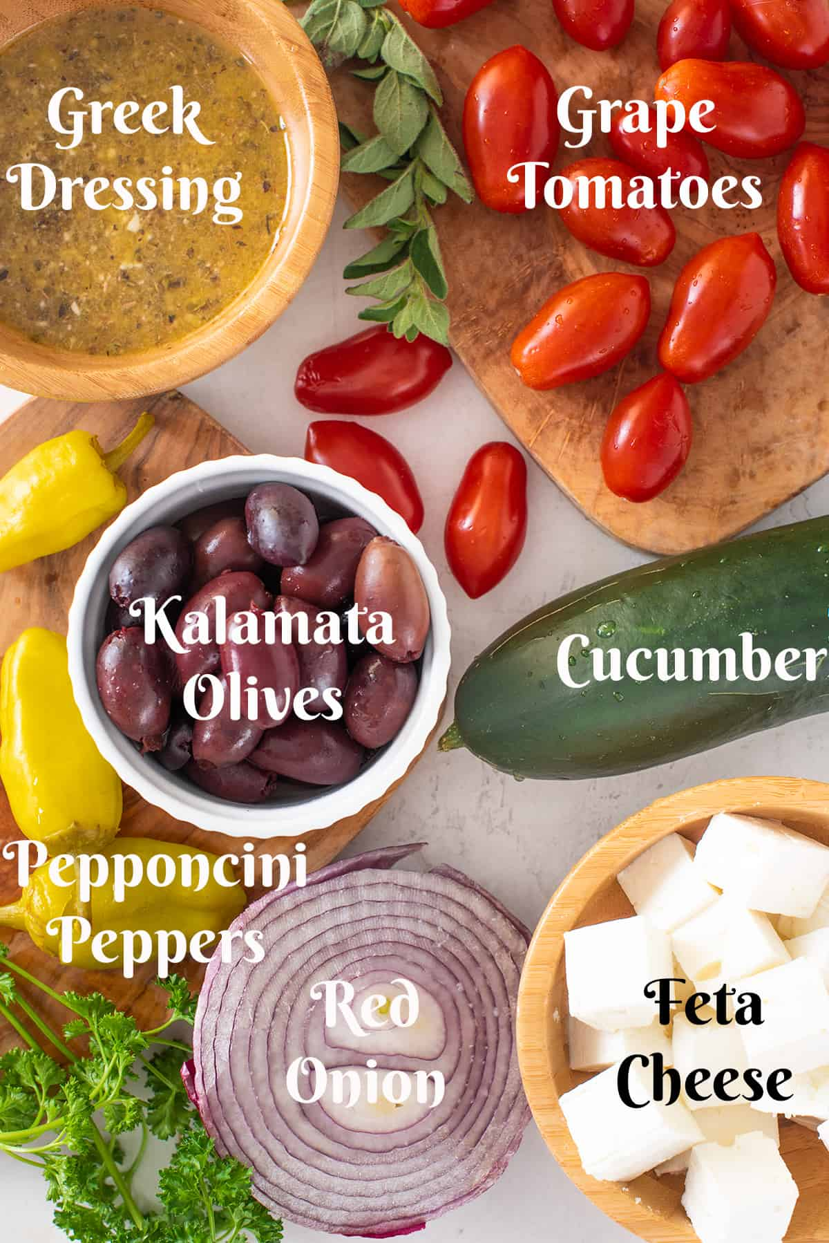 Greek salad ingredients with text labels.