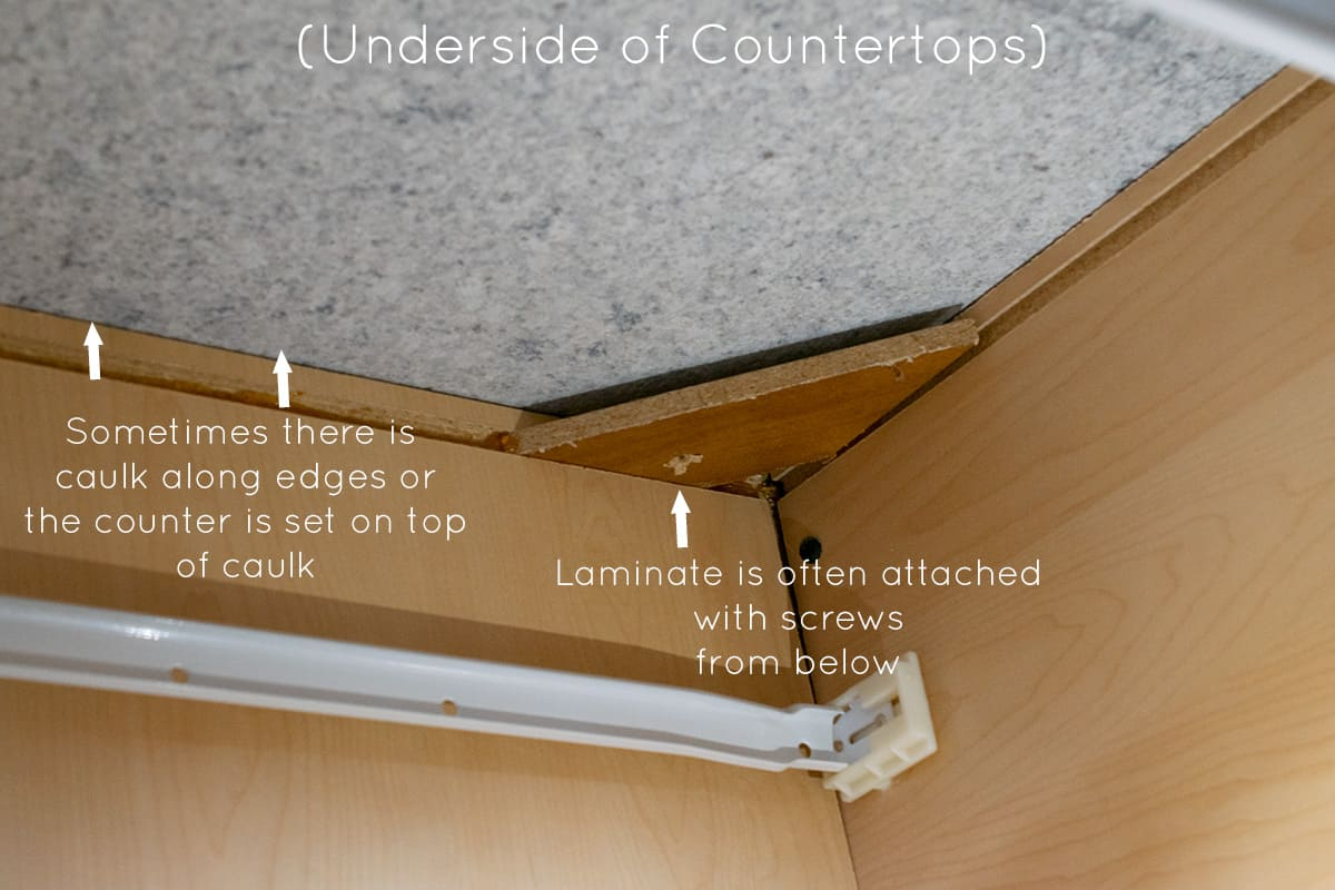 Demonstrating how to remove countertops by showing where they attach.