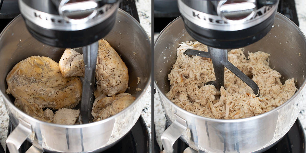 Shredded chicken in a kitchen aid mixer with paddle attachment.