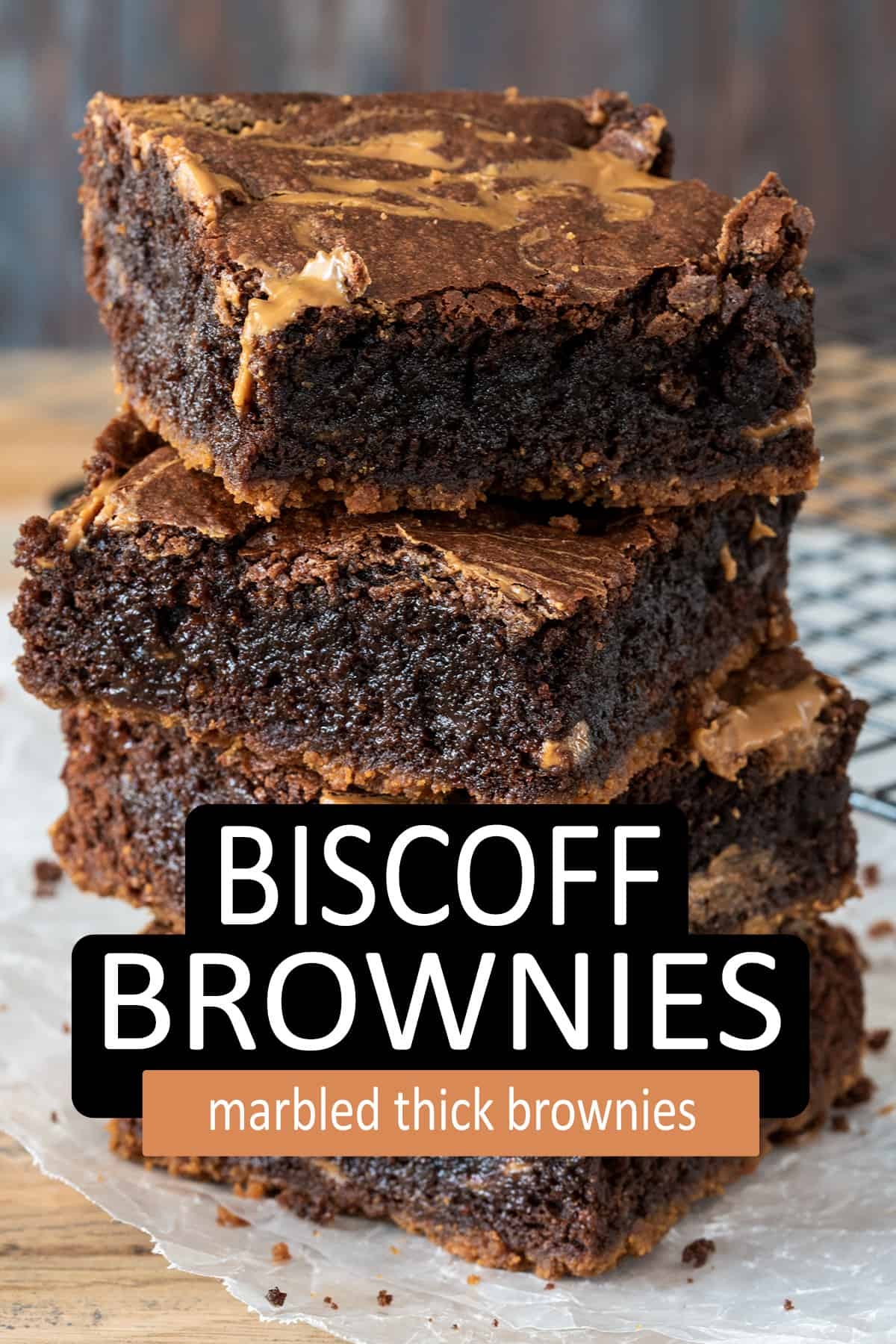 Biscoff Brownies stacked on parchment paper.
