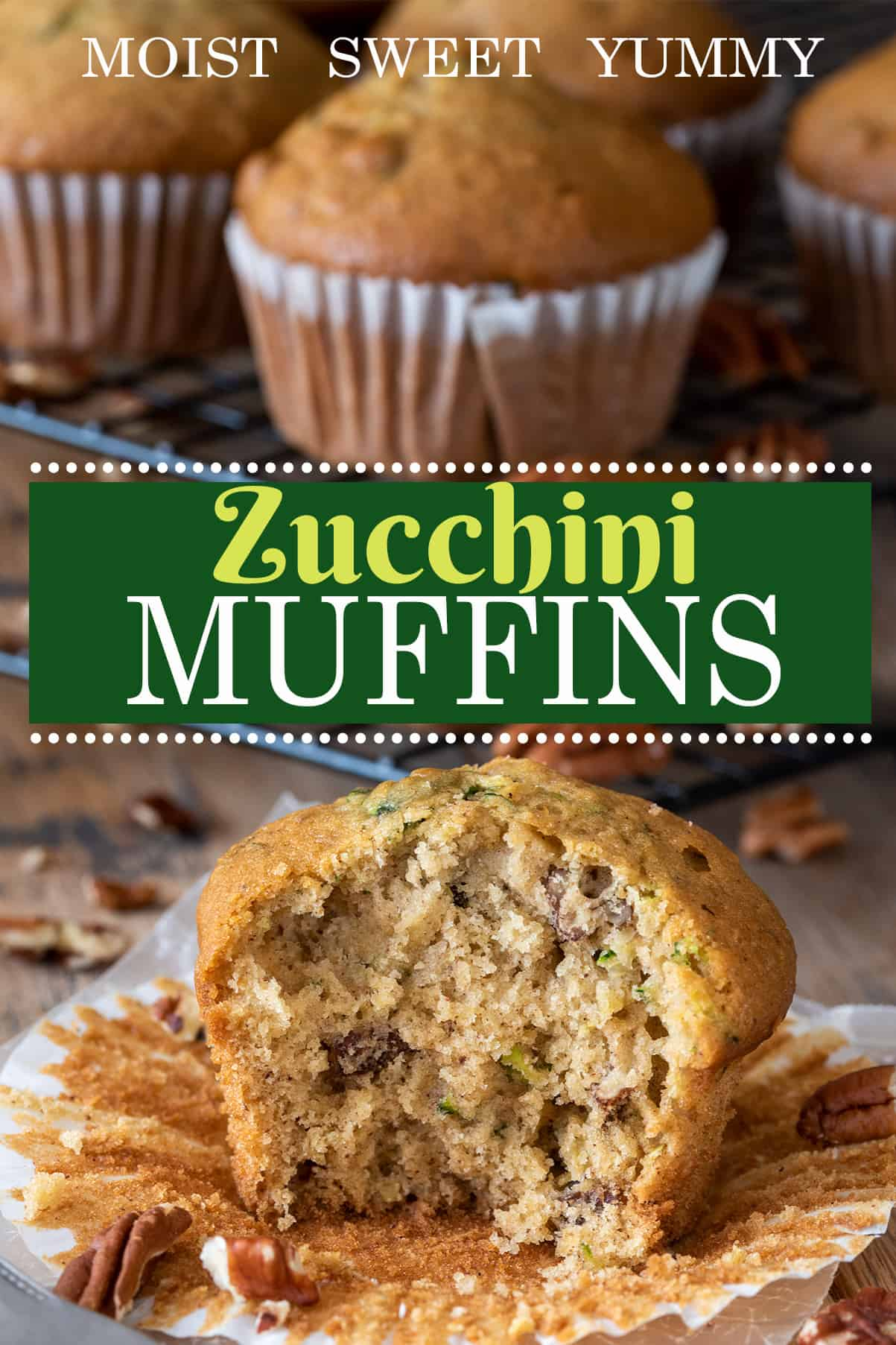 Healthy zucchini muffin in a paper wrapper with more muffins in the background. Text label for recipe.