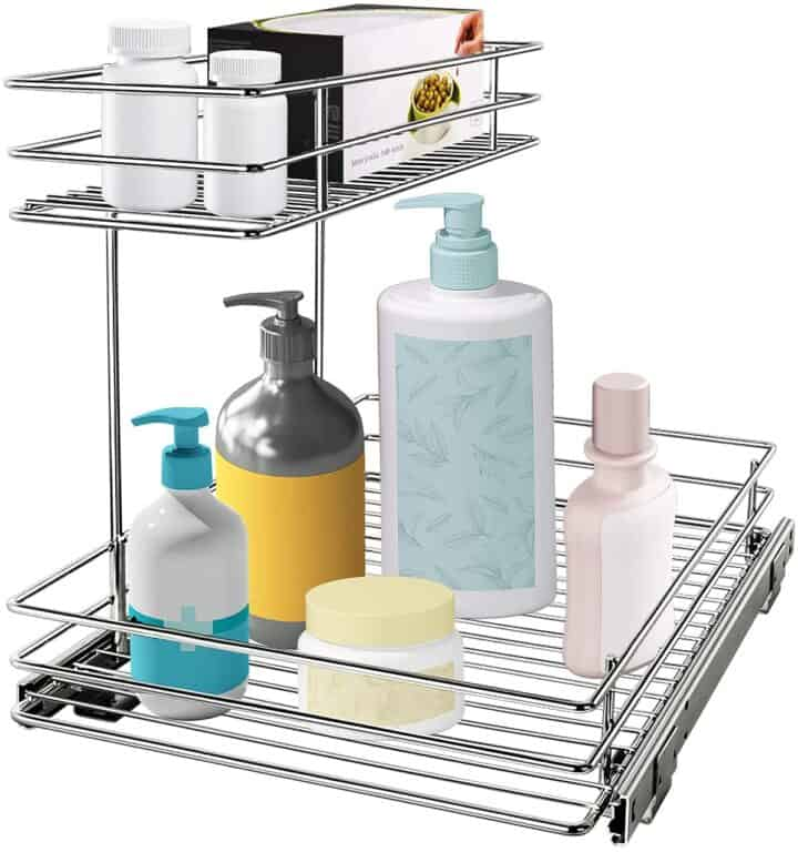 Tiered pull out tray with bottles standing in it. On white background.
