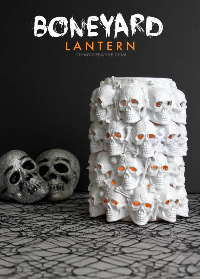 Large jar decorated with plastic skulls with title that reads boneyard lantern.