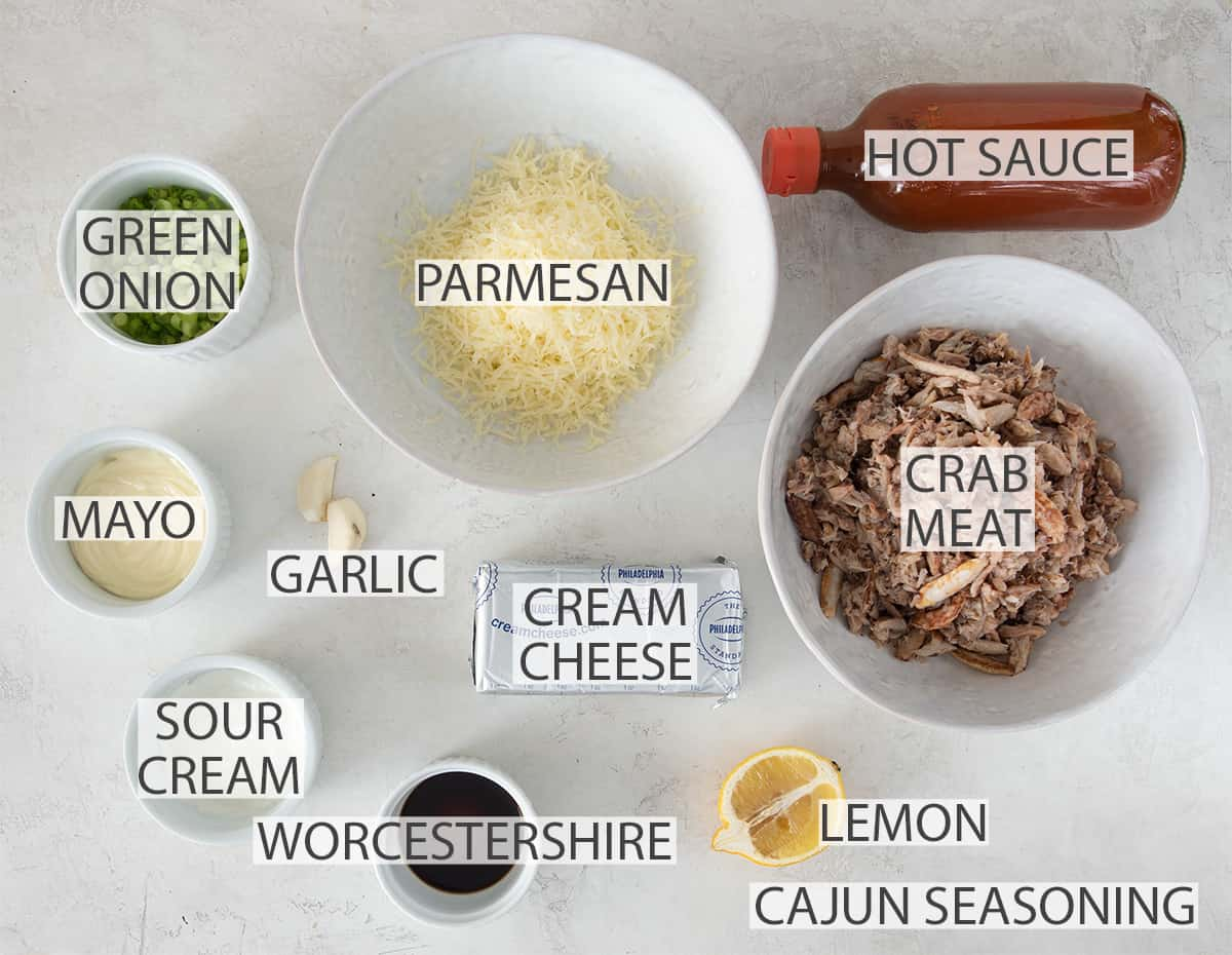 Ingredients for hot crab dip laid out with text labels.