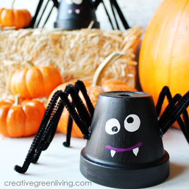 A diy spider craft made from a flower pot and pipe cleaners.