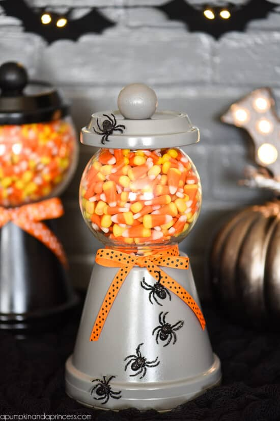 Candy corn in a jar made from plant pots.