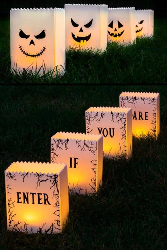 DIY halloween luminaries that have jackolantern faces on one side and Enter if you Dare on the other.