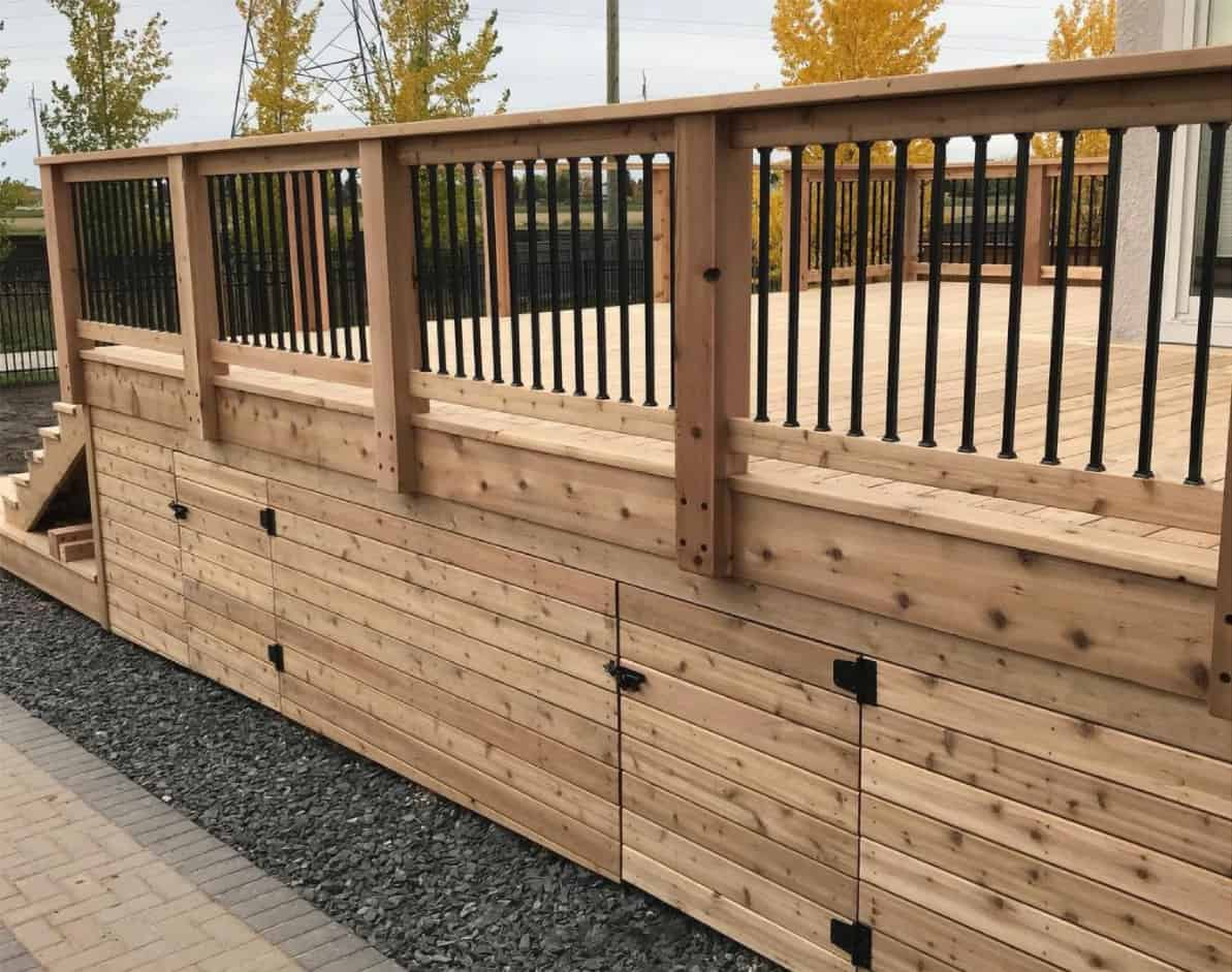 Side aspect of a wood deck with two doors cut out under the deck for access.