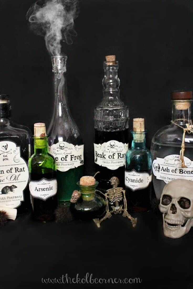 Apothecary bottles with various labels on them for Halloween party décor.