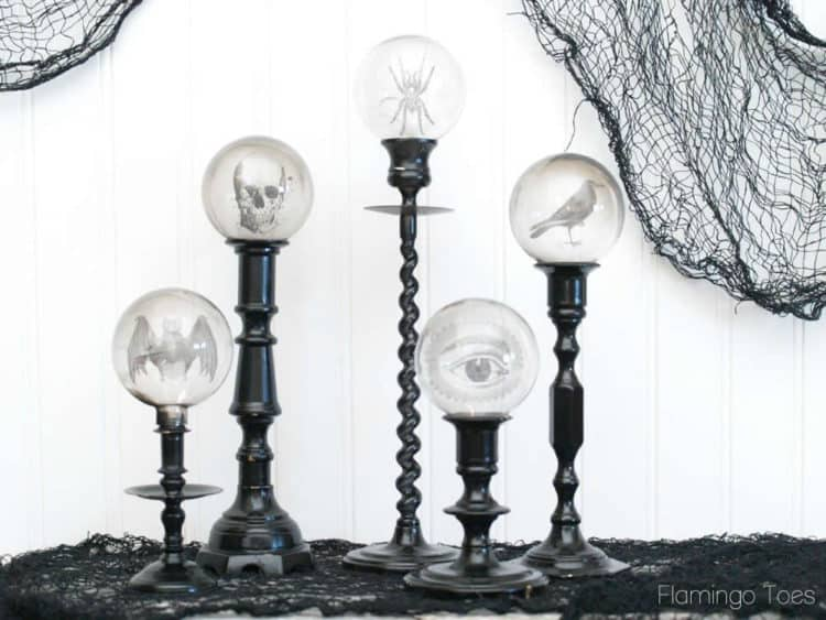 DIY candlesticks with images that glow inside of them.